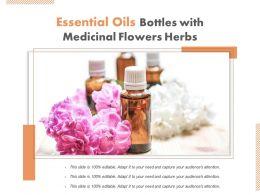 Essential Oils Bottles With Medicinal Flowers Herbs