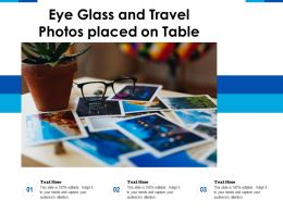 Eye Glass And Travel Photos Placed On Table