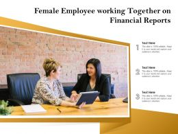 Female Employee Working Together On Financial Reports