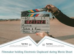 Filmmaker Holding Electronic Clapboard During Movie Shoot