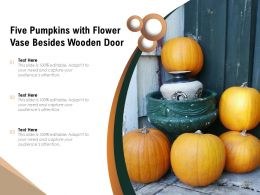Five Pumpkins With Flower Vase Besides Wooden Door
