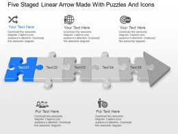 Five Staged Linear Arrow Made With Puzzles And Icons Powerpoint Template Slide