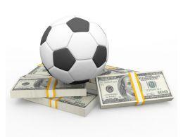 Football Residing Above Dollars Stock Photo