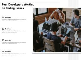 Four Developers Working On Coding Issues