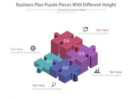 Four Different Height Puzzles And Icons For Business Plan Powerpoint Slides