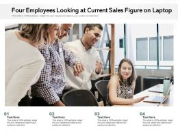 Four Employees Looking At Current Sales Figure On Laptop
