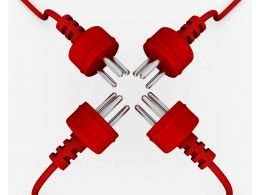 Four Plugs In Red Color Facing Each Other In Technology Stock Photo