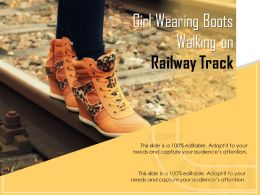 Girl Wearing Boots Walking On Railway Track