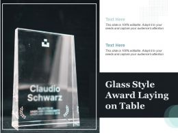 Glass Style Award Laying On Table