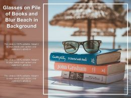 Glasses On Pile Of Books And Blur Beach In Background