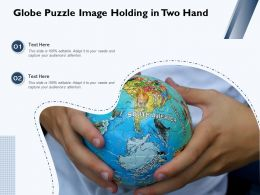 Globe Puzzle Image Holding In Two Hand