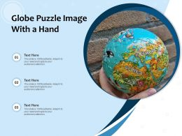 Globe Puzzle Image With A Hand