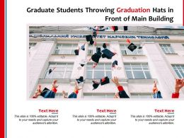 Graduate Students Throwing Graduation Hats In Front Of Main Building