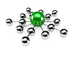 Green Ball In Centre Making Network With Silver Balls Stock Photo