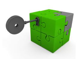 Green Cube Made Of Puzzles With Key For Security Stock Photo