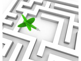 Green Dart In Middle Of The Maze For Business Target Stock Photo