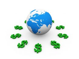 Green Dollar Signs Around Globe For International Economy Stock Photo