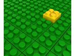 Green Lego Blocks Background With One Yellow Block As Leader Stock Photo
