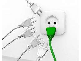 Green Plug With White Plugs And One Socket For Leadership Stock Photo