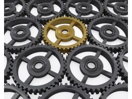 Grey Gears Showing Concept Of Standing Out Stock Photo