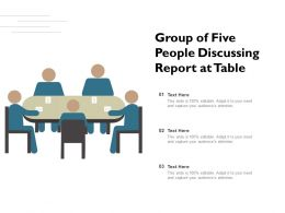 Group Of Five People Discussing Report At Table