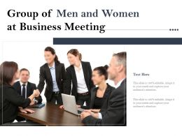 Group Of Men And Women At Business Meeting