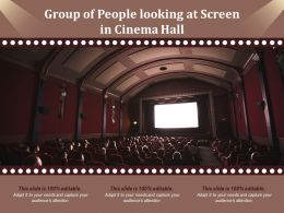 Group Of People Looking At Screen In Cinema Hall