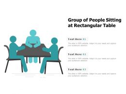 Group Of People Sitting At Rectangular Table