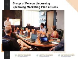 Group Of Person Discussing Upcoming Marketing Plan At Desk