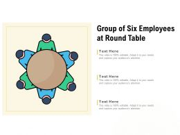 Group Of Six Employees At Round Table