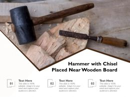 Hammer With Chisel Placed Near Wooden Board