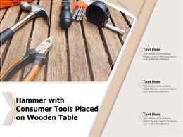 Hammer With Consumer Tools Placed On Wooden Table