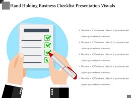 Hand Holding Business Checklist Presentation Visuals