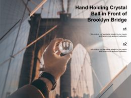 Hand Holding Crystal Ball In Front Of Brooklyn Bridge