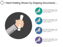 Hand Holding Shown By Gripping Documents Diploma Or Certificate