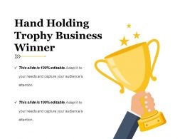 Hand Holding Trophy Business Winner Ppt Example Professional