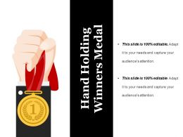 Hand Holding Winners Medal Ppt Background Designs