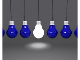 Hanging Light Bulbs With One Glowing As Leader Stock Photo