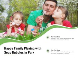 Happy Family Playing With Soap Bubbles In Park