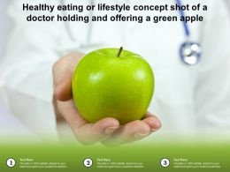 Healthy Eating Or Lifestyle Concept Shot Of A Doctor Holding And Offering A Green Apple