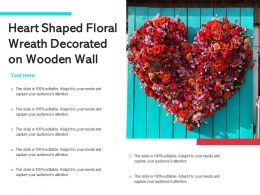 Heart Shaped Floral Wreath Decorated On Wooden Wall