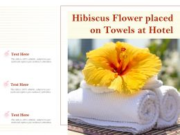 Hibiscus Flower Placed On Towels At Hotel