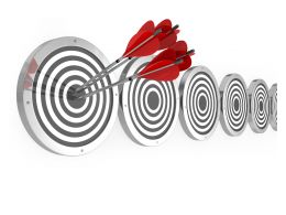 Hitting A Target On A Board Showing Focus On Goal Stock Photo