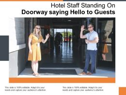 Hotel Staff Standing On Doorway Saying Hello To Guests