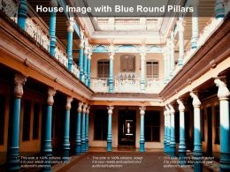 House Image With Blue Round Pillars