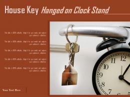 House Key Hanged On Clock Stand
