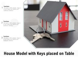 House Model With Keys Placed On Table