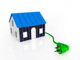House With Green Plug Solar Energy Concept Stock Photo