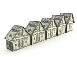 Houses In A Row Made By Dollars Stock Photo