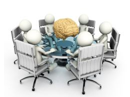 Human Brain In The Center Of Team Stock Photo